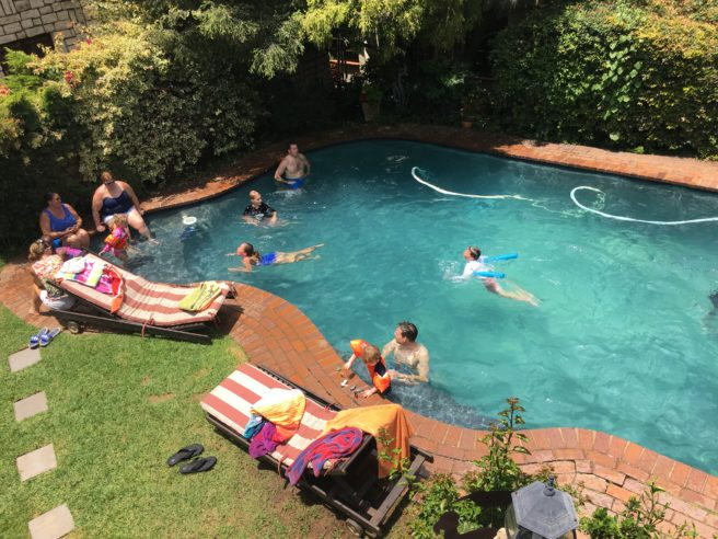 Families swimming in the pool